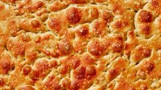 Focaccia Bread - The salty, springy bread that looks like the surface of a distant planet. Take us there.