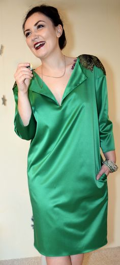Beautiful emerald-green satin dress with sparkling shoulder detail. Relaxed and effortlessly elegant.