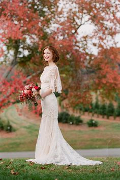 Vintage wedding gown, fluttery sleeves, lacy // Jen Fariello Photography