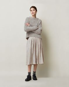 Finely pleated skirt in a textured, lustrous, linen/silk matka. Concealed zip at back with rouleau loop and button fastening. Grosgrain waistband.