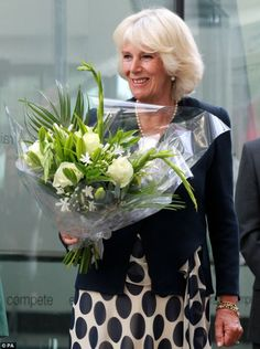 Floral arrangement: The Duchess of Cornwall beamed as she was given flowers after the official opening
