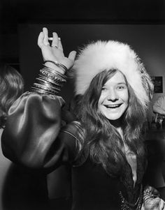 Janis Joplin waves to the camera at a party while wearing her signature fur hat, circa 1969. photo Walter Daran