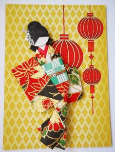 https://flic.kr/p/zhqYPn | ATC1287 - Celebrating the holidays | ATC with hand-folded Japanese paper doll. Traded at AFA.  Materials: Background (design print from 123RF); kimono (yuzen washi); obi (origami paper); paper and card stock strips; hair and obi strip decor (nail art sticker).