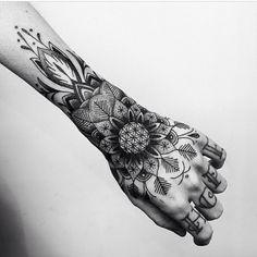 Wrist forearm woman tattoo