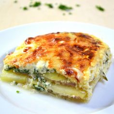 The Best Cheesy Ham and Potato Casserole – you can't resist this simple, classic layered ham and cheese bake that's easy to make for brunch, lunch or dinner! All you need is a few ingredients: potatoes, ham, swiss cheese, parsley, eggs and half and half milk. Quick and easy dinner idea. Video recipe. | tipbuzz.com