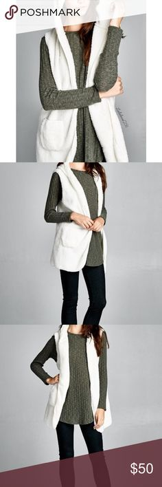 Luxury Faux Hooded Vest Open front, hooded faux fur vest. •Has two pockets at waist. •This vest is made with lightweight soft faux fur fabric that is very fluffy and very warm. Jackets & Coats Vests