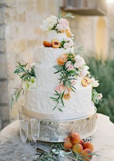 Beautiful wedding cake with fruit and floral accents. #wedding #dessert