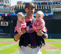 Proud father Joe Mauer with his twin girls. Minnesota Twins Baseball.