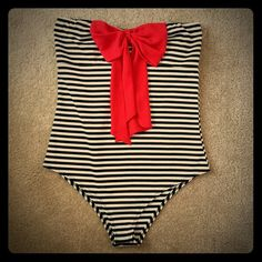 Bodysuit Striped body suit w red bow! Bnwot. Is so adorable to wear w palazzo pants and wide brim hat, platforms! Hot! Has partial tag/ ripped it off -never tried on or worn marked 1x but it's just an XL. (absolutely no returns) Tops