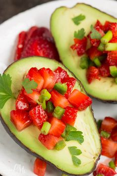 Strawberry Salsa Filled Avocados the combination of sweet, spicy, creamy, and crunchy is so good!