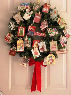 """my wreath with """"Christmas Apron ATCs"""" attached with tiny clothespins"""
