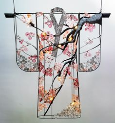 """Kimono with Cherry Blossoms 45"""" wide x 45"""" high This Kimono displays cherry blossoms and graceful branches in a beautiful color palette of pinks & greys. Available in many different color combinations& different sizes. It can also be made as a wall sconce. Composed of: glass rosettes, glass beads and pained & foiled finishes. Handmade in New York."""