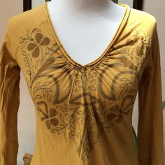 Top by Pink Lotus for Athleta Long sleeve in EUC.  Embellishments and design in front. Pink Lotus Tops