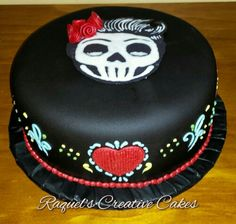 Delicate piping, fondant roses and chocolate skull plaque.