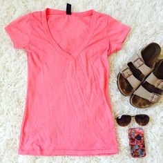 Soft Cotton Blend V-neck Coral T-shirt! Soft Cotton Blend V-neck Coral T-shirt! Originally purchased at Urban Outfitters, tag has faded but it is a size small. This comfy soft shirt has some piling, but no tears or stains  Urban Outfitters Tops Tees - Short Sleeve