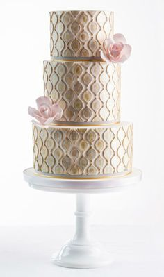 Stunning wedding cake - incredible detail, sleek and modern with a touch of art deco inspiration.