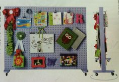 From Oct2011 Redbook:Use pegboard as a divider in kids' room. Nail 2-in plywood strips along the edge of 2 pegboards to create space between them. Then attach casters and employ it as a rolling wall. Genius!