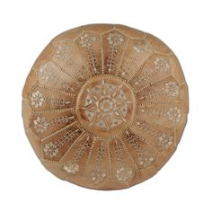 For quirky spare seating or a soft place to rest your feet, there's no beating a handsome leather pouf. This Moroccan-styled beauty is richly embroidered in a monochromatic starburst pattern, with gorg...  Find the Sahara Embroidered Pouf, as seen in the Under the Harvest Moon Collection at http://dotandbo.com/collections/under-the-harvest-moon?utm_source=pinterest&utm_medium=organic&db_sku=CAS0048