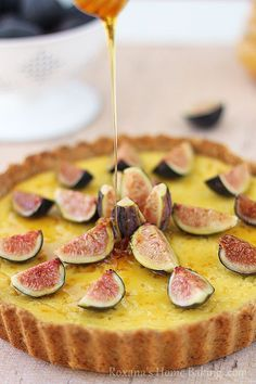 A creamy, sweet ricotta tart brushed with honey and decorated with fragrant fresh figs. Recipe from http://roxanashomebaking.com