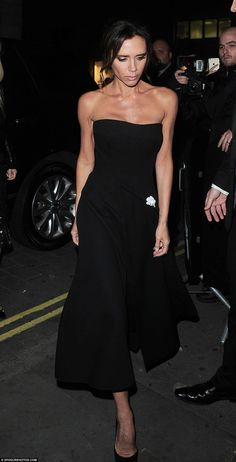 Victoria Beckham cuts an elegant figure in strapless black dress as she and son Cruz support Romeo at the Burberry festive film premiere | Daily Mail Online