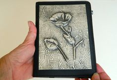 Kindle Case with beautiful pewter repousse poppy design. This image is available for various Kindle models. A super gift for a lady.