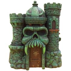 """Masters of the Universe Castle Grayskull Statue by Icon Heroes. He-Fans rejoice as Icon Heroes proudly presents this incredible statue of Castle Grayskull! Designed and painted by the biggest Masters of the Universe fans, Nate Baertsch and the Four Horsemen. No detail was overlooked, and fans can now show off Castle Grayskull in its entirety with rarely seen parts of the castle. Castle Grayskull statue size: 9.75""""H x 9""""W x 11""""D. Price: $124.99   Also sold @ http://www.MonstersInMotion.com"""
