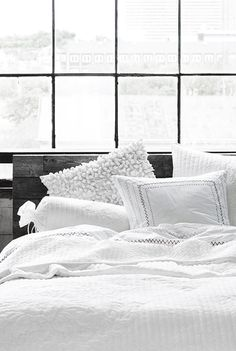 This looks pretty cozy! I like the variation of textures, but how the monochromatic choices tie it all together. I also like the rustic headboard.