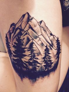 Mountains and tree tattoo by Angus Hendry