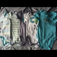 1$ onesies 1$ onesies each.. 1st photo all Calvin Klein.. 2nd photo all Gerber.. 3rd Photo all Carters.. 4th photo misc.. All size 0-3months, 3months.. Some never worn.. Take all 28 for 18$ Other