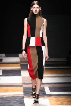 This look is from Salvatore Ferragamo - Fall 2015. It seems to be a color blocking take on the surrealist, op art influenced fashion in the 1960s.