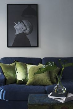inky blue sofa with green cushions                                                                                                                                                                                 More
