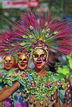 Portrait of a masked dancer in colourful costume at Mardi Gras carnival, in Iloilo City on Panay Island, Philippines, Southeast Asia, Asia