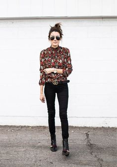 A floral-printed top with jeans and boots.