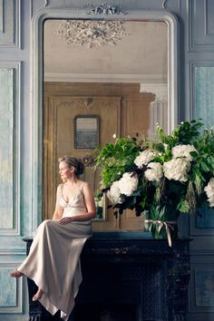 Carla Coulson portrait Paris Beautiful floral arrangement and fireplace.