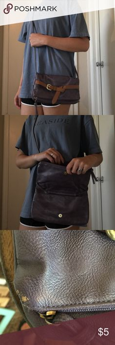 """Old Navy purple cross body purse Old Navy brand. Faux leather cross body purse. Wear on the corner where the zipper is. Fold over cross body. 5.5"""" H folded over. 10"""" H unfolded. 10"""" W X 0.5"""" D. Old Navy Bags Crossbody Bags"""