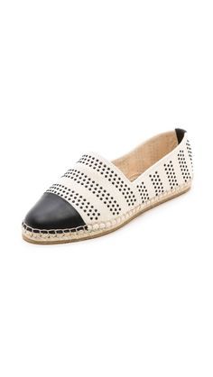 A leather cap lends classic appeal to charming, dotted-canvas Loeffler Randall espadrilles.