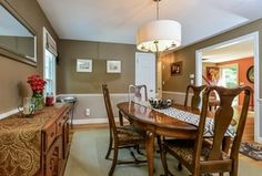 Traditional Dining Room with Hardwood floors, Carpet, Chandelier, Chair rail