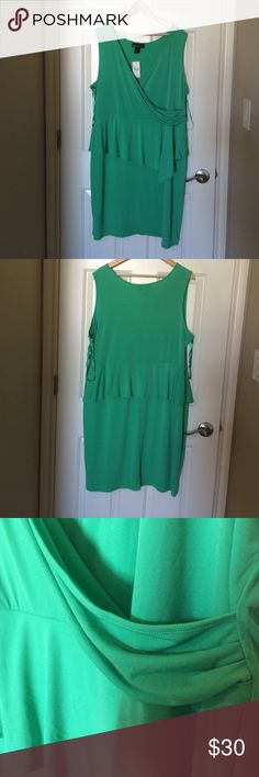 Emerald green peplum dress Emerald green peplum dress with asymmetrical detail. New with tags and never worn (sadly). 95% polyester 5% spandex. Lane Bryant Dresses Midi