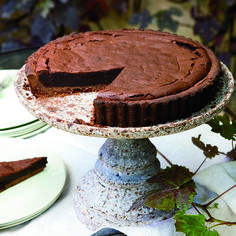 Chocolate-Bourbon Tart   Michael Glissman's tart is like a dark-chocolate truffle in a crisp, flaky cocoa crust. Bourbon adds a wonderful smokiness; be sure to heat it carefully with the sugar so it doesn't ignite.