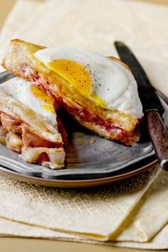 """NYT Cooking: This is a variation of Amanda Hesser's <a href=""""http://cooking.nytimes.com/recipes/1017345-croque-monsieur"""">croque-monsieur</a>, a ham and Gruyere sandwich topped with béchamel. Here, we invite you to pop a fried egg on top. Voila! A croque-madame (reportedly named such because the egg resembles a lady's wide-brimmed hat)."""
