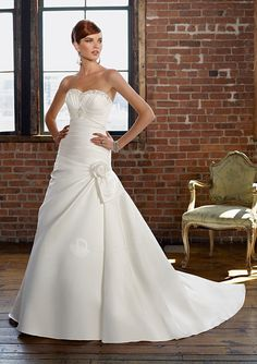 This new 2011 wedding dress features its satin strapless beaded sweetheart neckline with ruched bodice and a line skirt in lace up back and simple wedding designs.  1. Material: Satin  2. Length: Chapel Train  3. Neckline: Sweetheart/Strapless  4. Silhou 2013 wedding dresses