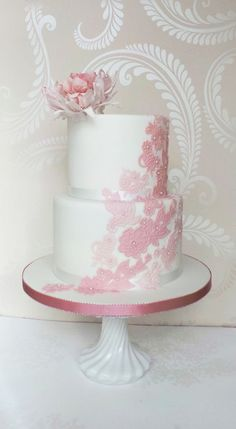 My own hybrid flower design in dusky faded pink on a two tier lace embellished white wedding cake