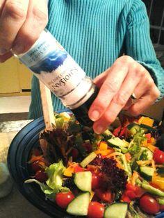 Grinding west coast khoisan sea salt over salad. Simply delicious.