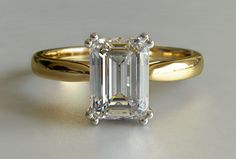 Emerald Cut Diamond Solitaire Engagement Ring in Yellow Gold