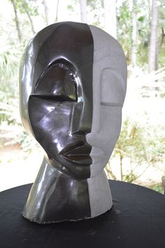 A beautiful Shona sculpture that has a wonderful representation of love. A peaceful expression combined with the two different tones, then combined to create a whole face. Another example of the talen