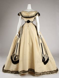 Ivory silk ball gown with black lace and fringe trim (front), by Emile Pingat, French, ca. 1860.