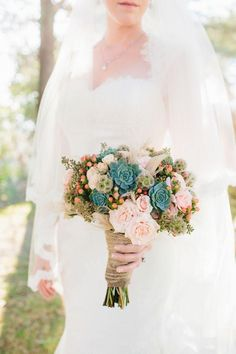 This bouquet beautifully incorporates summer succulents. They almost look like teal roses, nestled in with their pale pink counterparts.
