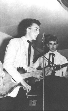 A young looking John Lennon with a Reslo RB Ribbon Microphone and Eric Griffiths performing this new fangled skiffle music as The Quarrymen en.wikipedia.org/wiki/Skiffle    Saturday, 23rd November 1957 New Clubmoor Hall, Back Broadway, Liverpool.    The  Looking for great handmade products for gifts or personal collectibles.  Visit www.Pandhara.com
