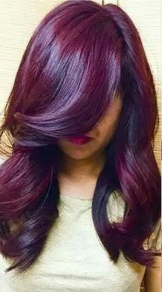 Say hello to a shade that is running rampant this fall: Winter Plum. And, with a ton of different variants to play with, this trend is popular among a variety of skin tones and styles. Here, we see a darker shade of plum play up the dramatic side of purple. But let the creative colorist inside you run wild! These purple hues are easily balayaged into a violet ombre or deep burgundy hair color