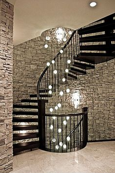 this would be awesome if this spiral staircase went to the basement and the basement had this stone wall.